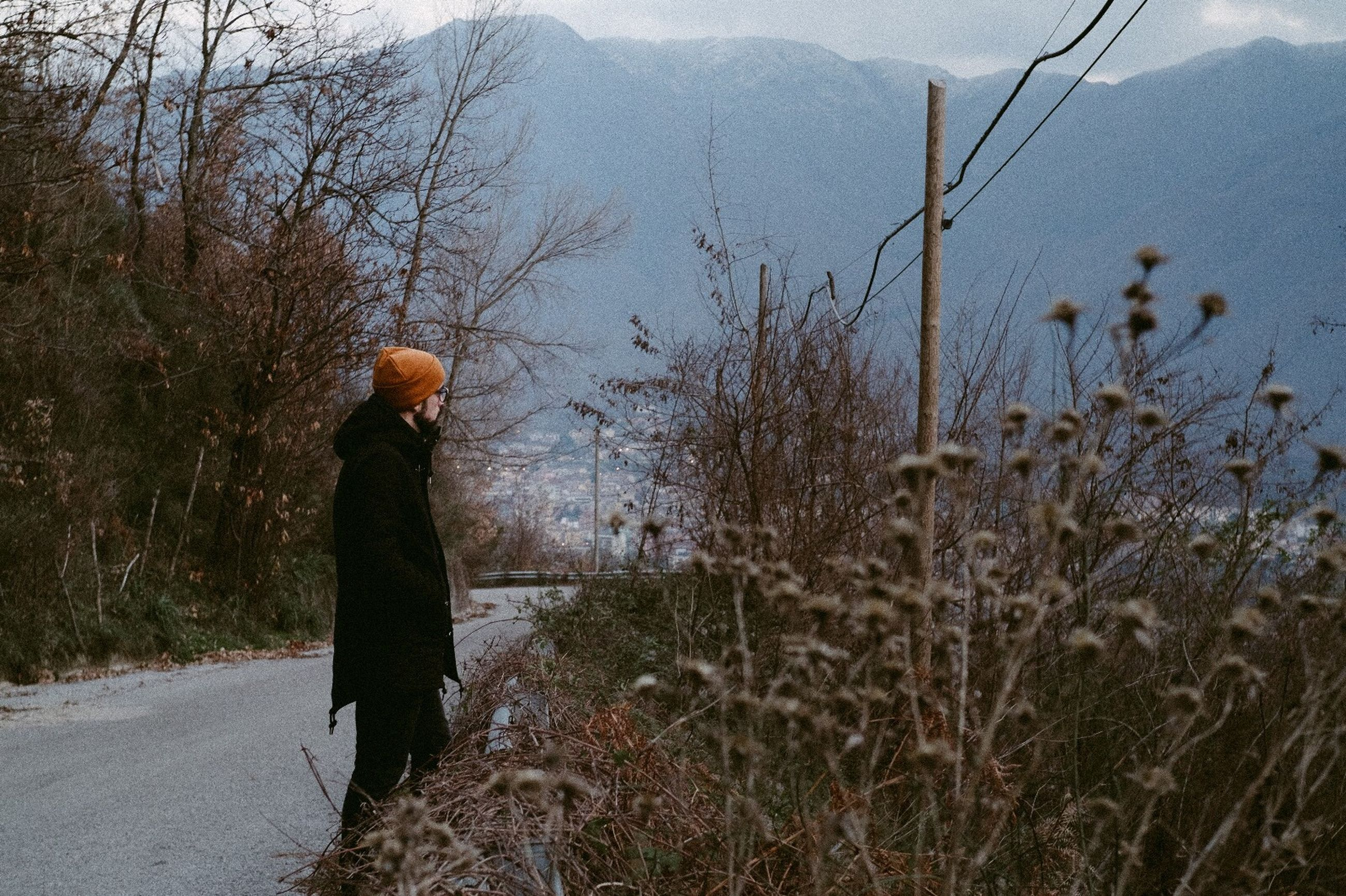 rear view, one person, full length, outdoors, nature, bare tree, winter, real people, tree, women, warm clothing, day, cold temperature, sky, one woman only, beauty in nature, adult, people