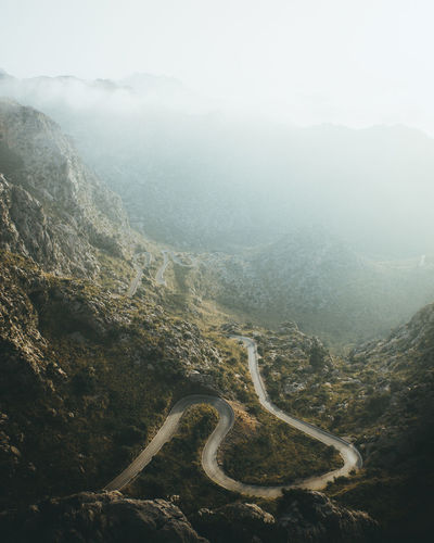 The winding roads of Sa Calobra, Mallorca, Spain. Mallorca Nature Nature Photography SPAIN Sunlight Beauty In Nature Day Environment Fog High Angle View Landscape Mountain Mountain Range Mountain Road Nature Nature_collection No People Outdoors Road Scenics - Nature Sun Sunset Tranquil Scene Tranquility Winding Road
