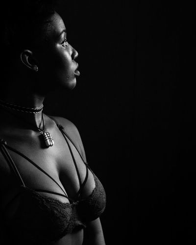 Jeze. One Person Headshot One Woman Only Beauty Black Background EyeEmNewHere Afronoir Studio Shot Noirphotography Portrait Jamaicanphotographer Jamaica Blackgirlmagic Jamaican Girl  Blackgirl Black And White Profile View Real People