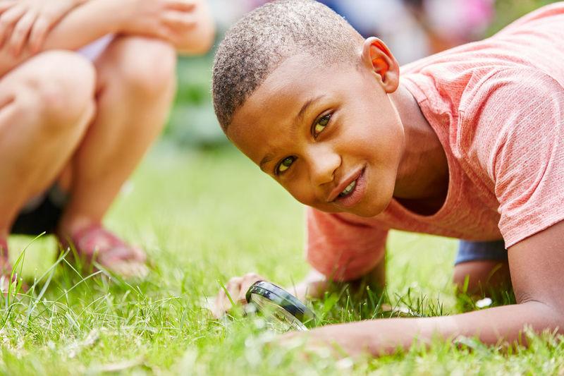 Portrait of boy playing on field