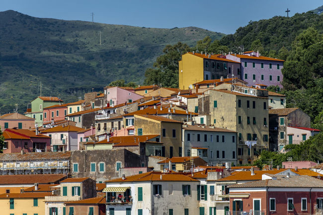 Rio Marina, Elba Colourful Elba Island Italy EyeEm EyeEm Gallery Summertime 🌞 Architecture Building Building Exterior Built Structure City Community Day Italy🇮🇹 Mountain No People Outdoors Residential District Rio Marina Elba Italy Sky Sunlight TOWNSCAPE