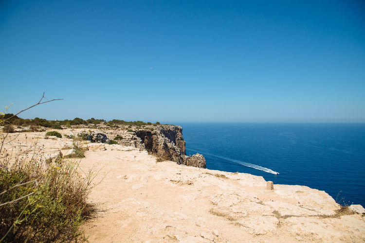 Beauty In Nature Blue Boat Calm Clear Sky Cliff Coastline Copy Space Day Footpath Holidays Horizon Over Water Nature Non-urban Scene Outdoors Remote Scenics Sea Seascape Solitude SPAIN Tourism Tranquil Scene Tranquility Water