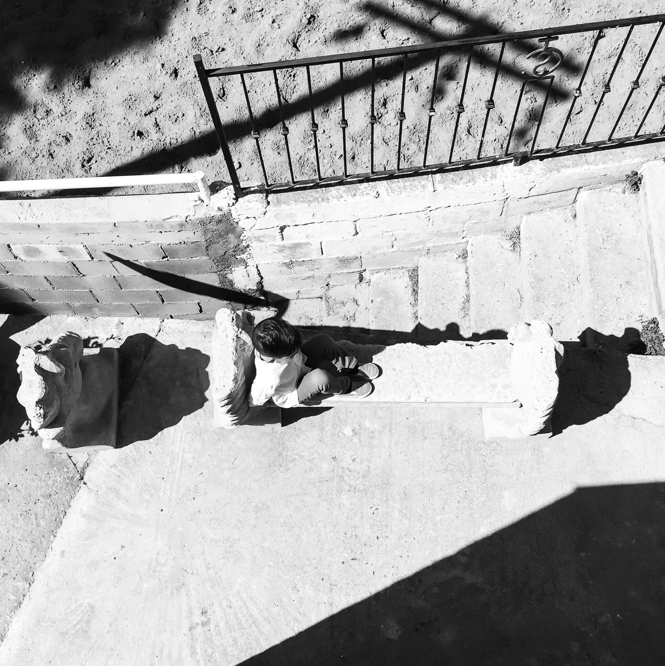 high angle view, shadow, sunlight, sand, beach, day, relaxation, steps, water, outdoors, no people, nature, railing, in a row, pattern, built structure, paving stone, shore, absence, bench