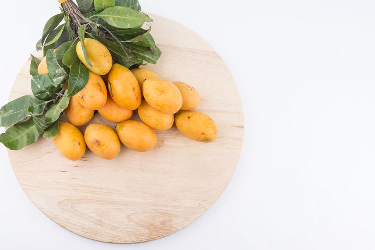 Plum mango with isolated white background Agriculture Apricot Asian  Dessert Exotic Isolated Juice Mango Maprank Nature Thailand Food Fresh Fruit Isolated White Background Leaf Nutrient Orange Color Organic Plum Mango Sweet Food Taste Tropical Climate Vitamin Yellow