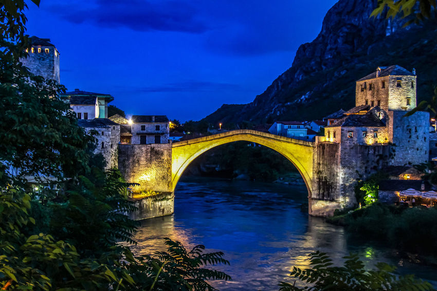 Mostar Mostar Bosnia Mostar Bridge Arch Arch Bridge Architecture Bridge - Man Made Structure Built Structure Cloud - Sky Connection Illuminated Nature Neretva River Night No People Outdoors Reflection River Sky Transportation Tree Water Waterfront