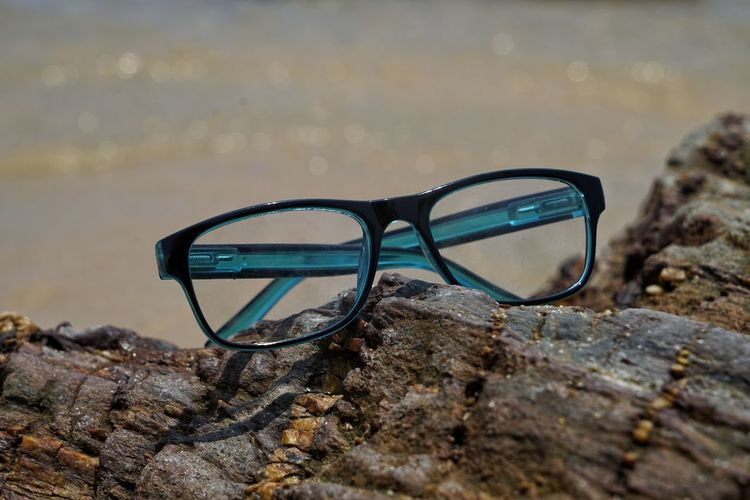 Glasses Rock Solid Rock - Object Personal Accessory Transparent Close-up Sunglasses Eyeglasses  Fashion Focus On Foreground No People Nature Day Land Glass - Material Still Life Beach Outdoors Security Eyewear