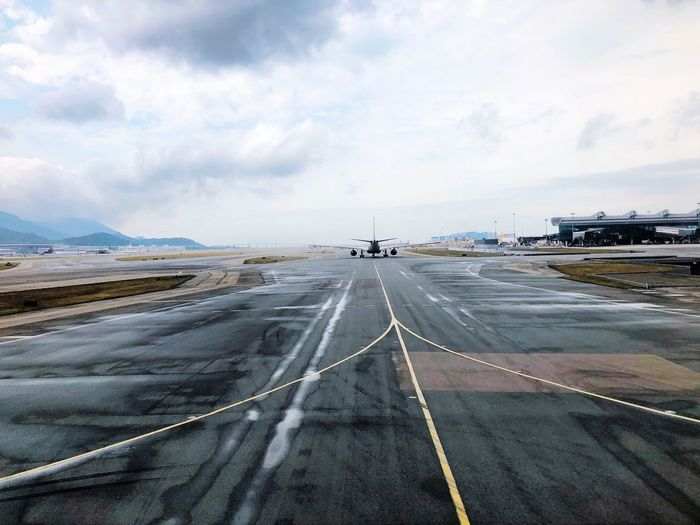 Transportation Sky Cloud - Sky Outdoors Day Airport Runway Road Airport Runway Airplane