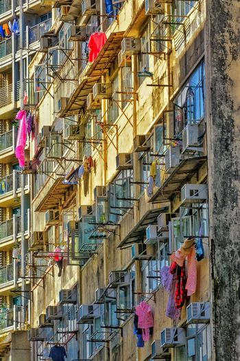 Full Frame Backgrounds Multi Colored Pattern Window Close-up Day No People Architecture Mood Captures Exceptional Photographs EyeEm Gallery Master Class Shape And Pattern Low Angle View Built Structure Air Conditioner Drying Clothes Human Condition Life In Color