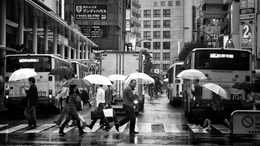 Wet Day Streetphotography Streetphotography Street City Architecture Building Exterior Street Group Of People Built Structure Men Real People Umbrella City Life Wet Rain Walking Crowd Lifestyles Large Group Of People Rainy Season