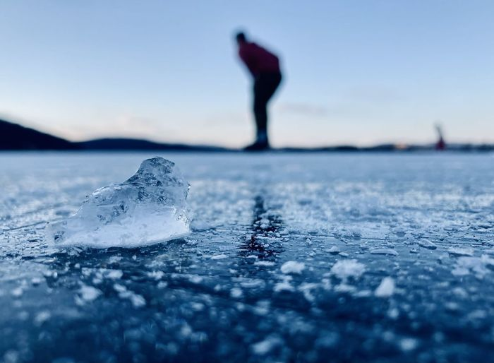 Surface level of frozen sea against sky