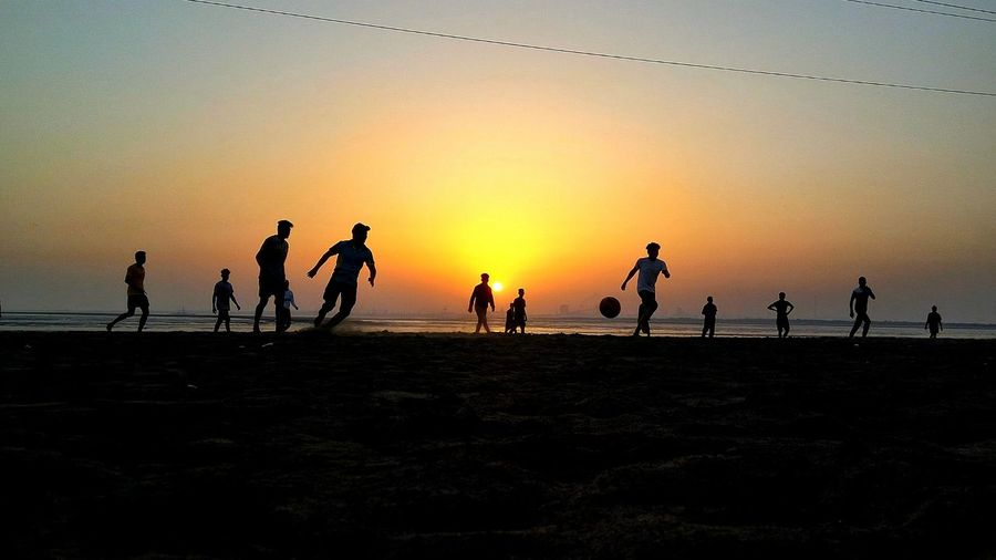 Sky Group Of People Sunset Land Beach Large Group Of People Silhouette Playing Sport Nature Group Crowd Sea Minimalism_masters Summer Exploratorium 10 The Street Photographer - 2018 EyeEm Awards