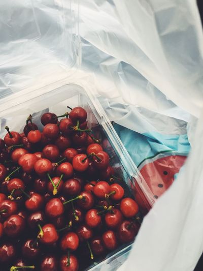 Close-up of red cherries in container