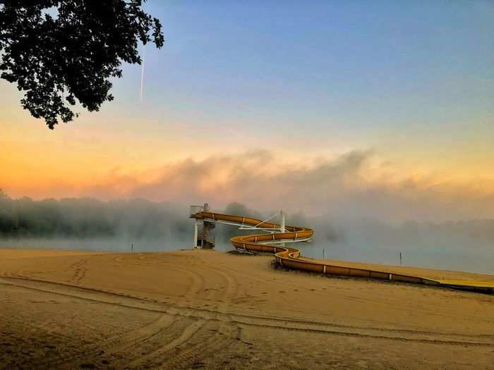 Sliding at the beach Beach Sliding Down Slide Sky Water Sunset Sea Nature Beach Beauty In Nature Sand
