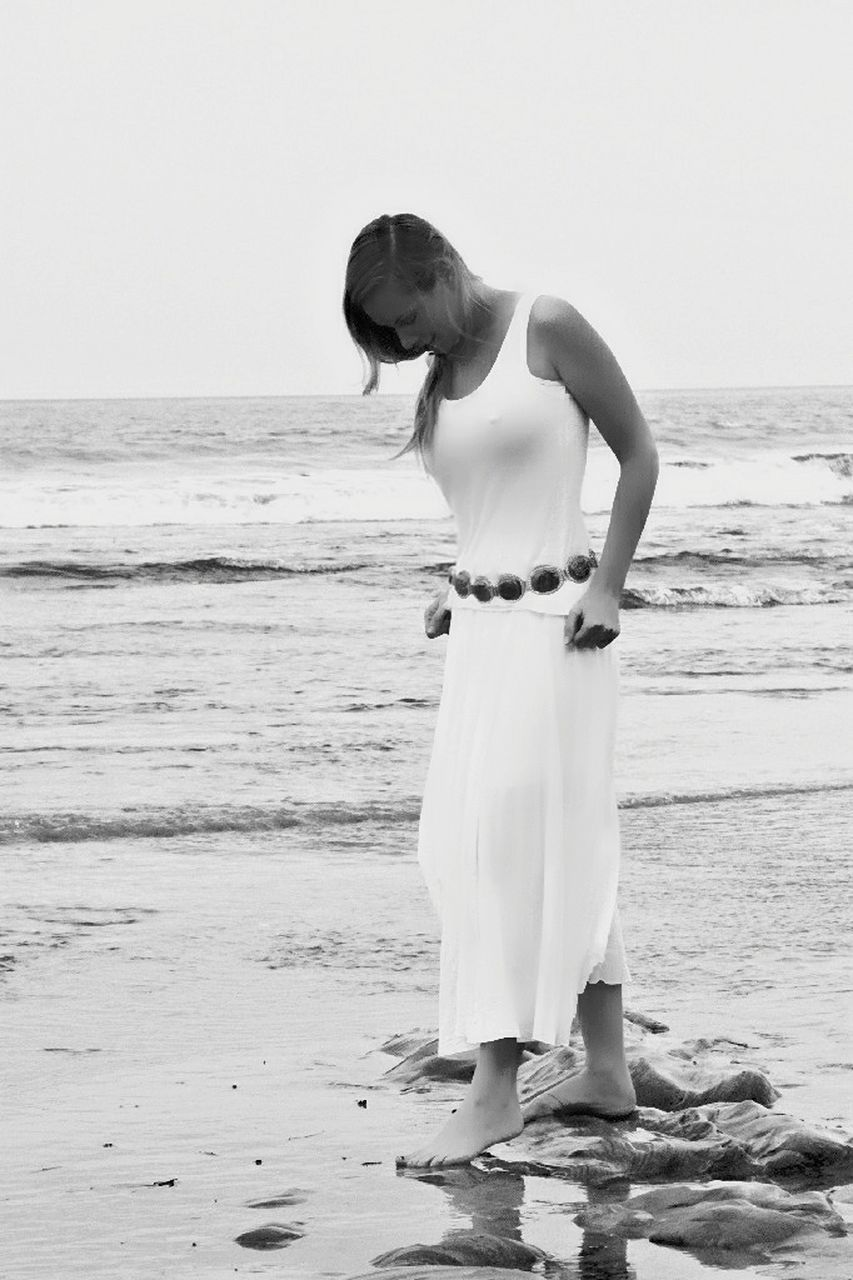 beach, sea, shore, sand, standing, real people, young adult, young women, full length, water, one person, horizon over water, beautiful woman, nature, beauty in nature, lifestyles, outdoors, leisure activity, wave, women, beauty, ankle deep in water, day, scenics, sky, adult, people