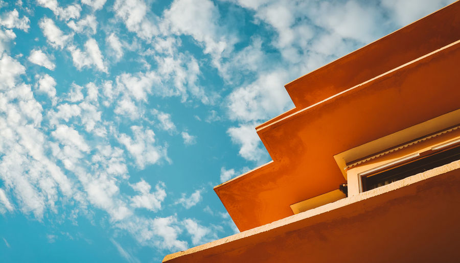 Colors Orange Outdoors Orange Color Blue Daylight Cloudy Day Beauty City Blue Sky Architecture Building Exterior Close-up Cloud - Sky Palace Directly Below Eaves