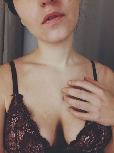 Midsection of woman wearing bra