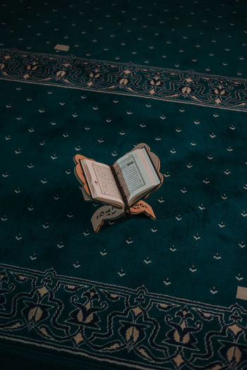 High angle view of book on floor