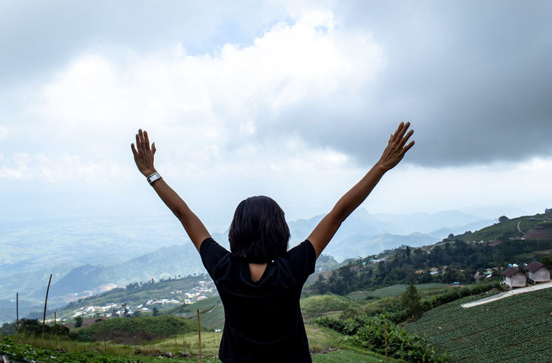 Sky Rear View One Person Human Arm Cloud - Sky Mountain Leisure Activity Landscape Nature Environment Arms Raised Limb Mountain Range Adult Beauty In Nature Lifestyles Real People Scenics - Nature Women Outdoors Hand Cityscape Hairstyle Looking At View