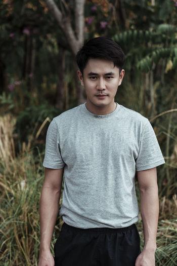 Portrait of man standing on land