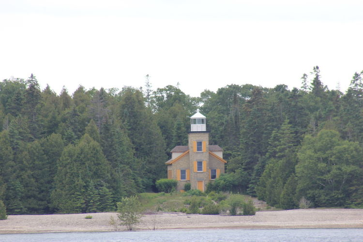 Architecture Beauty In Nature Bois Blanc Island Lighthouse Bois Blanc Island Mi Building Exterior Built Structure Clear Sky Day Growth Lighthouse Lighthouse Cruise Lighthouse_captures Lighthouse_lovers Nature No People Outdoors Scenics Sky Tranquil Scene Tranquility Tree Water