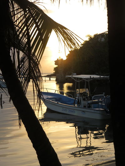 Beauty In Nature Boat Calm Honduras Island Island Life Mode Of Transport Moored Nautical Vessel Reflection Roatan Honduras Roatan Island Roatan, Honduras Roatanhonduras Sea Sky Solitude Sun Sunset Tranquil Scene Tranquility Transportation Travel The World Water Waterfront