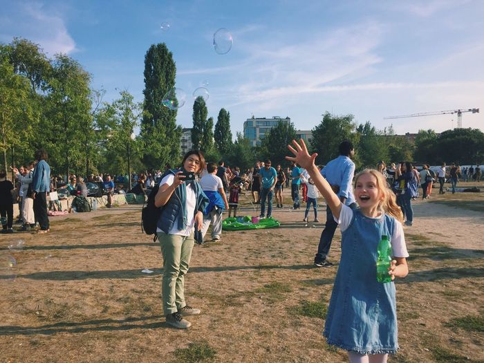 Leisure Activity Large Group Of People Lifestyles Casual Clothing Tree Sky Person Full Length Standing Friendship Front View Togetherness Cloud Young Adult Looking At Camera Fun Enjoyment Vacations Crowd Day