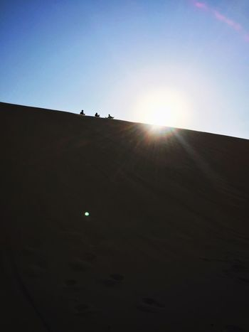 Lost In The Landscape Sand Dune Sunlight Silhouette Lens Flare Clear Sky Outdoors Sunset Sky Beauty In Nature Desert Landscape ShotOnIphone IPhoneography Perspectives On Nature