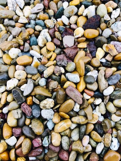 Full Frame Backgrounds Large Group Of Objects Abundance No People Stone - Object High Angle View Beach Still Life Choice Nature Pebble Variation Multi Colored Textured  Stone Day Solid Rock Land