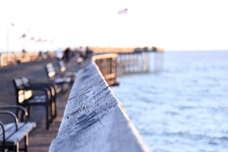 Close-Up Of Pier Over Sea Against Clear Sky