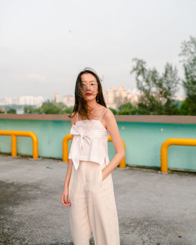 Hair In The Wind Portrait Of A Woman Portrait Photography Looking At Camera portrait of a friend Portrait Photography Singapore Young Women Portrait Water City Standing Long Hair Beauty Sky Natural Beauty