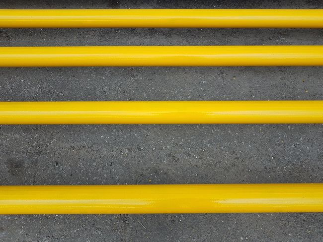 In A Row Abstract Asphalt Backgrounds Close-up Day Full Frame Grey And Yellow LINE No People Outdoors Parallel Pipes Road Street Textured  Yellow