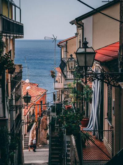 Buildings by sea in city