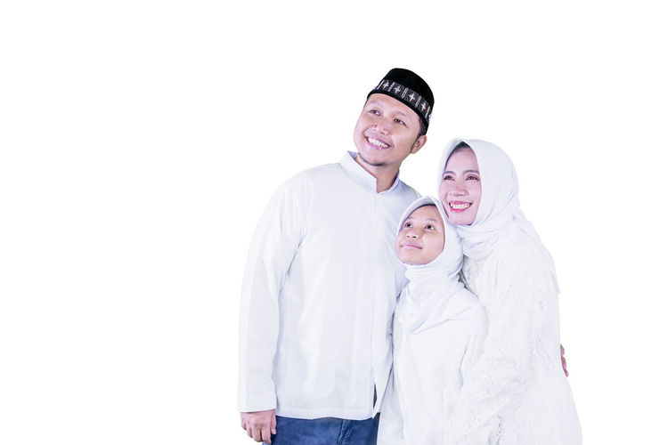 Portrait of happy friends against white background