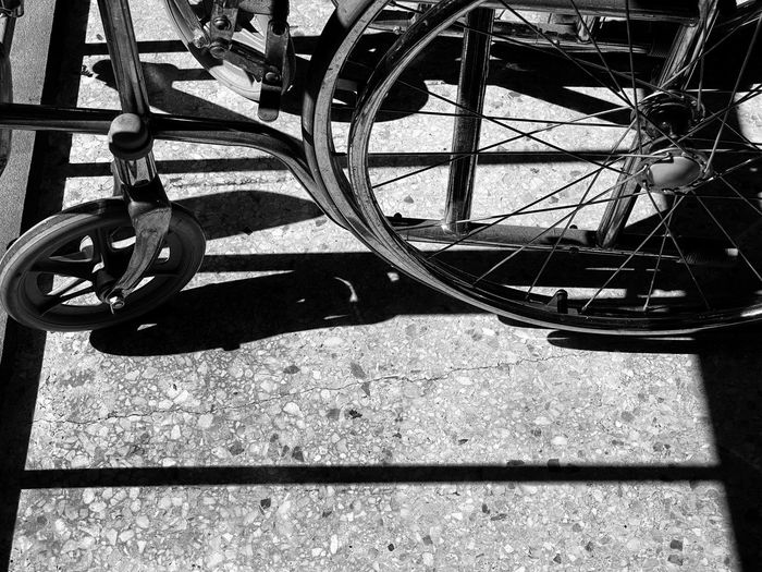 High angle view of bicycle wheel on sunny day