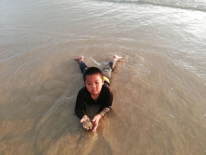 Children enjoy on summer trip 2019,หาดเจ้าหลาว Achi2019 One Person Leisure Activity High Angle View Water Sea Real People Portrait Lifestyles Full Length Day Child Enjoyment Looking At Camera Childhood Waterfront Motion Outdoors Innocence Boy