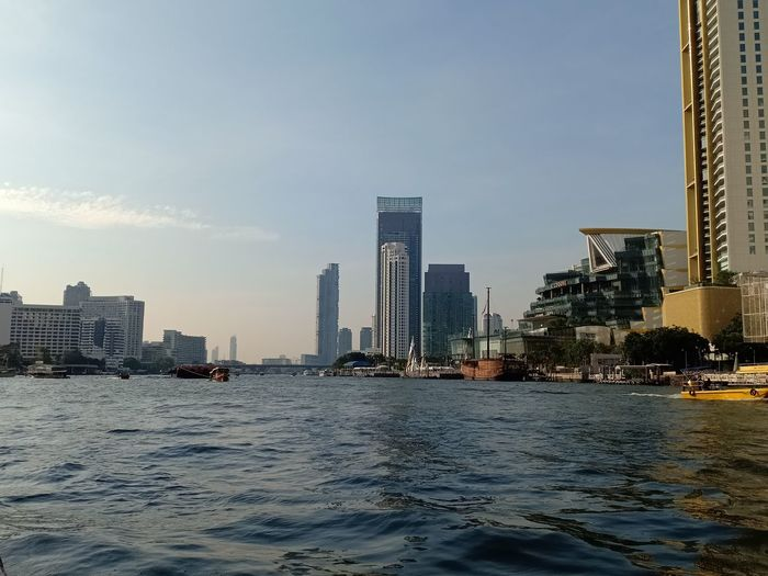Chaopraya river in this morning, Bangkok Thailand, December 18, 2018 River Riverside River View River Collection Riverview Outdoors Outdoor Pictures Thailand City Cityscape Modern Skyscraper Water Downtown District Office Building Exterior Tall - High Tower Waterfront Skyline