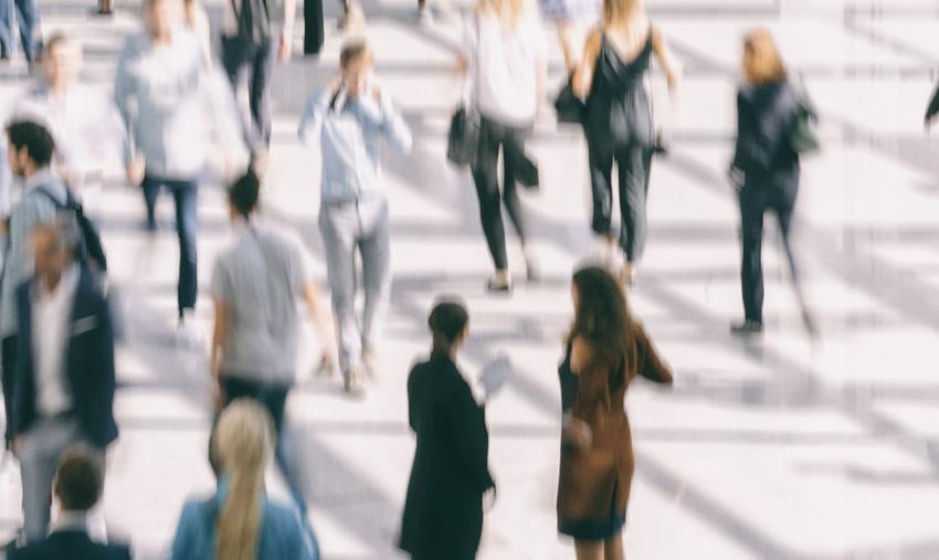 People walking on walkway in city