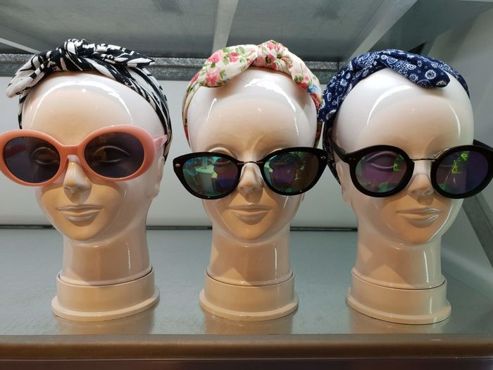 Close-up of headscarf and sunglasses on mannequins