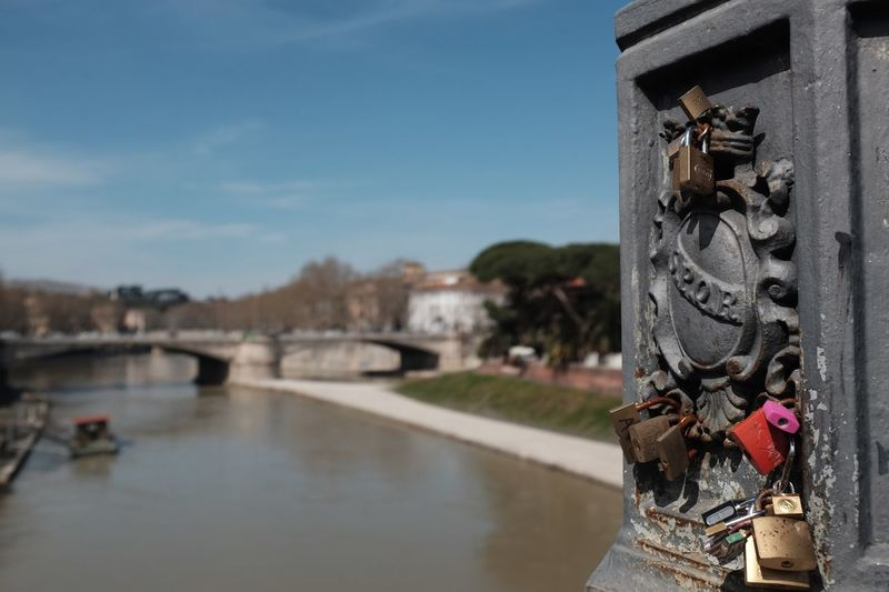 The Tiber River Tourism Ancient SPQR Water Built Structure Sky Architecture Nature Day Building Exterior No People River Bridge Bridge - Man Made Structure Focus On Foreground Lock Padlock