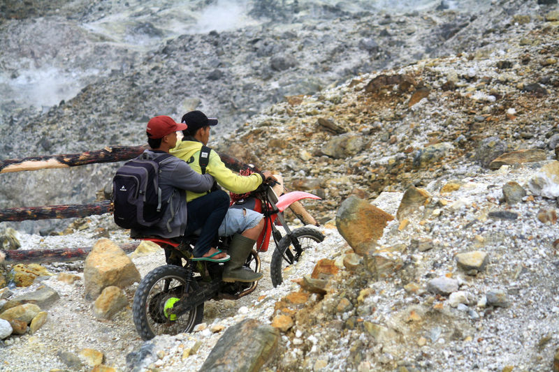 Farmer across Mount Papandayan Crater Local Transportation Ojek Adventure Climbing Crater Extreme Sports Mount Papandayan Mountain Nature Outdoors Rock Climbing Volcano