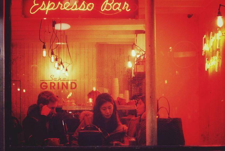Text Restaurant Communication Night Western Script Bar - Drink Establishment British Culture Women People Illuminated Sitting Food And Drink Indoors  Window Leisure Activity