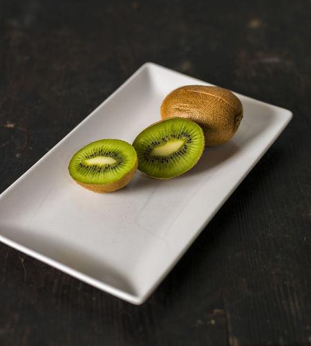 Fresh Kiwi fruits over a dark wooden table Acid Architecture Brown Dark Eating Healthy Food Fresh On Eyeem  Freshness Green Healthy Lifestyle Indulgence Kiwi Knife Purple S Vitamins