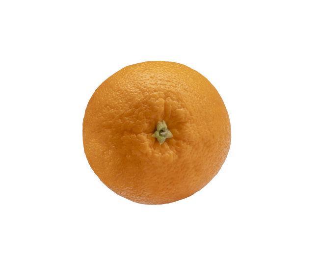Close-up of orange against white background