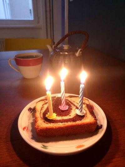 Lit tea light candles on table