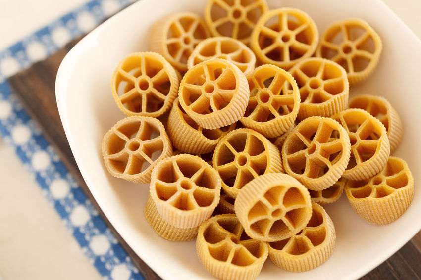 Carrot Rotelle pasta. Dry Italian pasta. Italian Pasta Noodles Carrot Pasta Classic Food Close-up Dry Pasta Food Food And Drink High Angle View Italian Food No People Pasta Rotelle Rotelle Pasta Still Life Table Traditional Food