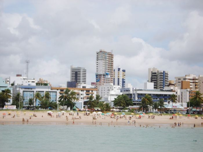 Panoramic view of beach against buildings in city