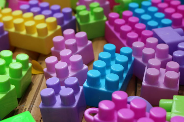 Close-Up Of Multi Colored Toy Blocks On Table