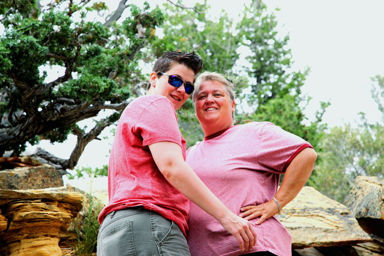 Dinosaur National Monument national park, Colorado. Lgbt Family Lesbian Couple Queer Women Gender Colorado Day Enjoyment Family Time Fun Gay In Love Lesbian Lgbt Lifestyles Love Low Angle View Nature Outdoors Portrait Smiling Summer Vacation Three Quarter Length Toothy Smile Tourism Tourists Tree Women