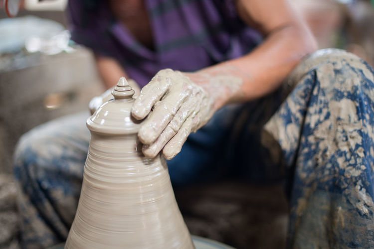 Porcelain  Adult Art And Craft Artist Ceramics Clay Craft Creativity Dirt Dirty Earthenware Expertise Hand Human Body Part Human Hand Making Molding A Shape Mud Occupation Outdoors Pottery Sculptor Skill  Spinning Working
