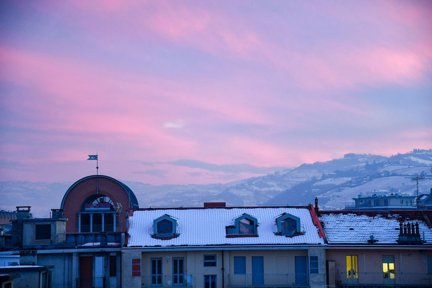 Pink sunset in winter Winter Sunset Pink Sunset Langhe Cityscape City Over The Roofs Outdoor Travel Destinations Beauty In Nature Snow City Snowed Roofs Snowy Sunset City Sunset Travel Architecture Built Structure Outdoors Building Exterior No People Day Sky
